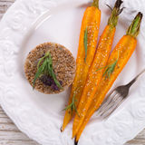 Wheat groats  and Caramelized carrots Royalty Free Stock Images
