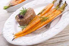 Wheat groats  and Caramelized carrots Royalty Free Stock Photo