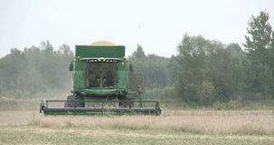 A wheat harvester running on the field Stock Photography
