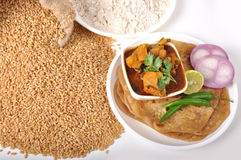 Wheat indian food - chapati & chicken. With flour Royalty Free Stock Photos