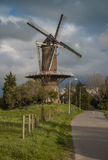 Wheat mill at Wolphaartsdijk, The Netherlands during tempestuous Royalty Free Stock Photography