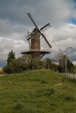 Wheat mill in Wolphaartsdijk, The Netherlands during tempestuous Royalty Free Stock Photography