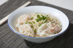 Wheat Noodle Soup with Shrimp Wonton. Popular Chinese Style Wheat Noodles soup with shrimp wonton served in white bowl Royalty Free Stock Photos