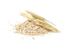 Wheat, Oat, Rye And Barley Flakes with Ears Royalty Free Stock Photography