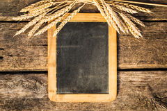 Wheat on old blackboard Royalty Free Stock Photos