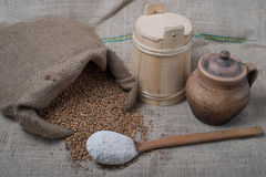 Wheat out of jute with spoon. Wheat out of jute  and fluor in wooden spoon Royalty Free Stock Photos