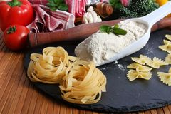Wheat and pasta. Beautiful shot of wheat pasta with wheat flour Stock Photos