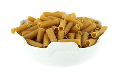 Wheat pasta noodles in bowl Royalty Free Stock Photos
