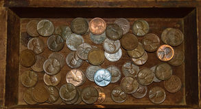 Wheat pennies in an old wooden box Stock Photo