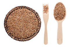 Wheat in a plate, fork and spoon Stock Photo