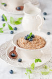 Wheat porridge. With berry and mint, selective focus Stock Image