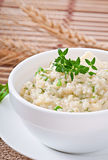 Wheat porridge with herbs Stock Image