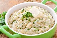 Wheat porridge with herbs Stock Photos