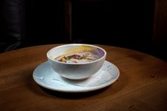 The wheat porridge. On the wooden table Royalty Free Stock Photography