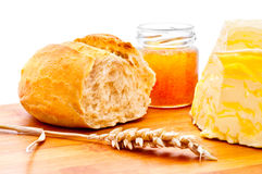 Wheat roll, butter and honey Royalty Free Stock Photos