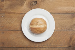 Wheat roll on plate and wood Stock Image