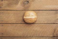 Wheat roll on wood Stock Images