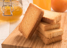 Wheat rusk in a wooden panel. With jam Royalty Free Stock Photos