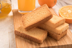 Wheat rusk in a wooden panel with jam. Wheat rusk in a wooden panel with jam Royalty Free Stock Photo