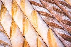 Wheat and rye baguettes lie side by side. Royalty Free Stock Images