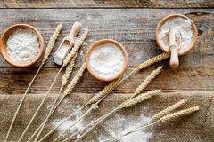 Wheat and rye ear for flour production on wooden desk background top view Stock Images