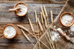 Wheat and rye ear for flour production on wooden desk background top view Royalty Free Stock Photos