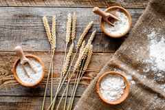 Wheat and rye ear for flour production on wooden desk background top view Royalty Free Stock Image