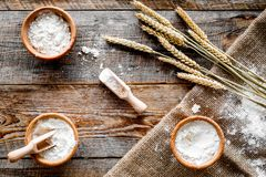 Wheat and rye ear for flour production on wooden desk background top view Stock Image