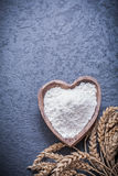 Wheat and rye ears wooden bowl with flour Royalty Free Stock Photo