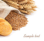 Wheat in a sack, ears and bread on a white background Royalty Free Stock Photos