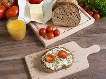 Wheat slice of bread with cheese and tomatoes on Stock Image