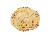 Wheat sourdough bun sprinkled with flax and sesame seeds Stock Photography