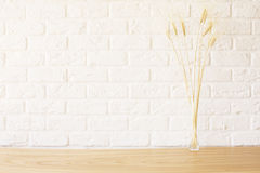 Wheat spikes on wooden desktop Stock Image