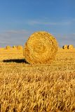 Hay bales in stubble fields during summer harvest time Picardy France. Wheat Stubble field and hay bales. Needle in a bale of hay. In Aisne department, Picardie royalty free stock image