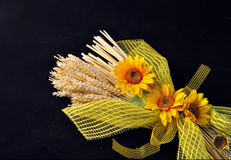 Wheat and sunflowers. Decoration consists of stalks of wheat and sunflowers on a black background stock images