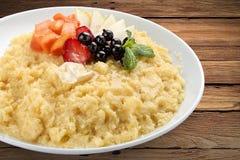 Wheat sweet porridge with fruit. royalty free stock photo