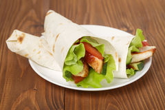 Wheat tortilla with chicken and vegetables Royalty Free Stock Image