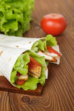 Wheat tortilla with chicken and vegetables Royalty Free Stock Photo