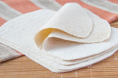 Wheat tortillas. Fresh wheat tortillas on bamboo desk with towel Royalty Free Stock Image