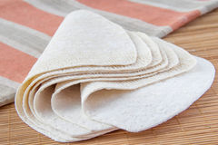 Wheat tortillas. Fresh wheat tortillas on bamboo desk with towel Stock Photography