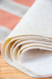 Wheat tortillas. Fresh wheat tortillas on bamboo desk with towel Stock Images