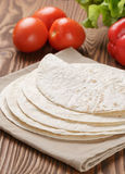 Wheat tortillas with vegetables on old wooden table Stock Photography