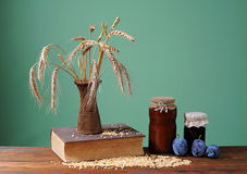 Wheat in a vase and plum jam Royalty Free Stock Photography
