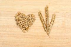 Wheat on wood Royalty Free Stock Photos