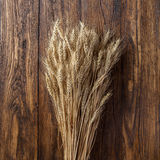 Wheat on wood Stock Photos