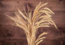 The wheat on wooden background Stock Image