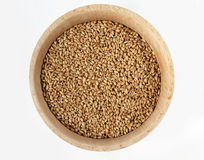 Wheat in wooden bowl stock images