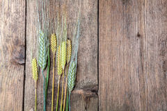 Wheat on wooden table Stock Photo