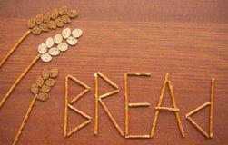 Wheatear hecho del pan con las letras Fotos de archivo