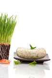 Wheatgrass and bar of soap Royalty Free Stock Images